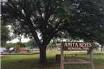 photo of park sign, picnic areas,  and playground